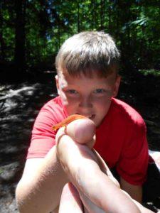 camper holding newt