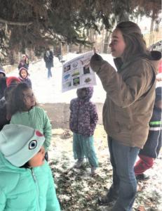 Kindergarten students go outside to hunt for animal habitats in their school yard.