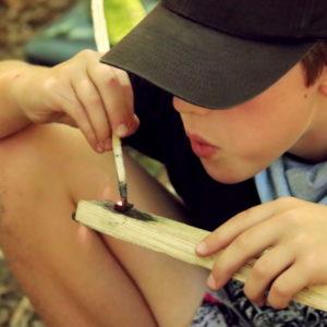 boy using a firestarter kit