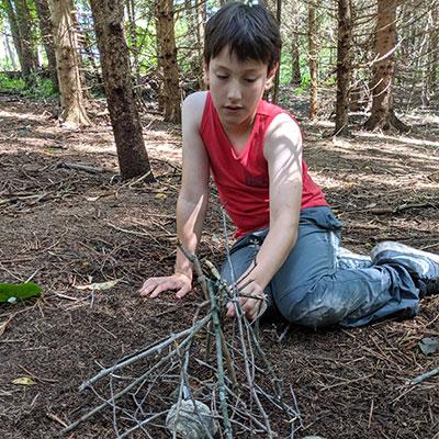 child-building-stick-house