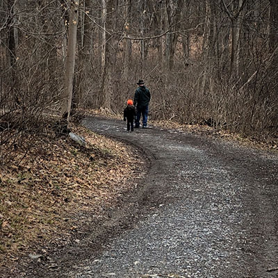 dad-and-son-walking along a stone road