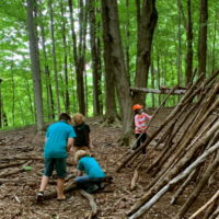 fort building at summer camp kids with sticks