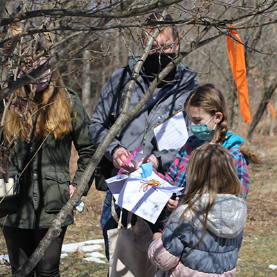 kids put ribbons on a tree and make a wish on earth day
