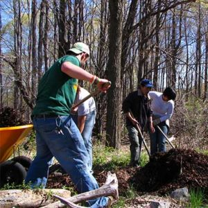 volunteers lay dirt along the trail