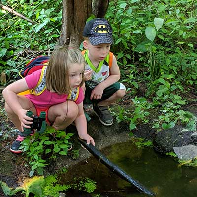 kids-search-water-with-stick