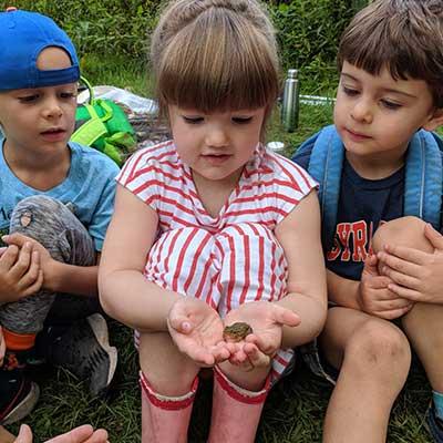 three-kids-hold-frog